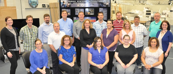 IMAGE: DAHLGREN, Va. (June 21, 2018) - New first-line supervisors from divisions across the Naval Warfare Centers are pictured during their tour of the Human Performance Laboratory at Naval Surface Warfare Center Dahlgren Division (NSWCDD). They are in the midst of a five-day course called 'Propel' that provides an introductory level awareness of Warfare Center expectations for supervisors. The NSWCDD tour and briefings - focusing on the Electromagnetic Railgun Facility, the Potomac River Test Range, and the Human Performance Laboratory - gave the Propel students a deeper look into the work being done at Dahlgren. Meanwhile, they have been increasing their collaboration and understanding of operations throughout the Warfare Centers. (U.S. Navy photo/Released)