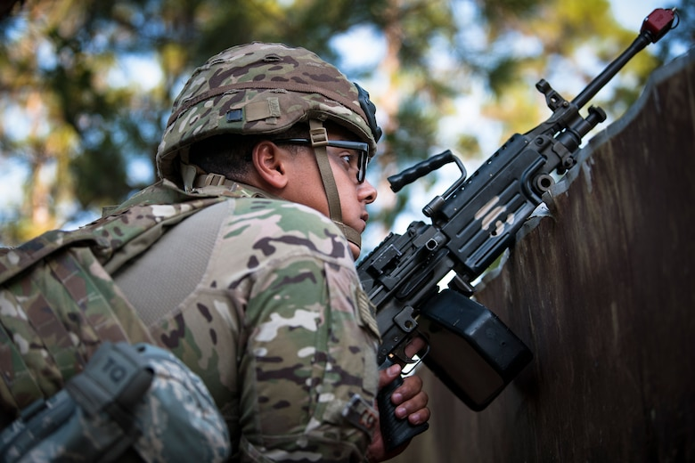Airman 1st Class Samuel Cortes, 822d Base Defense Squadron (BDS) fireteam member, guards a simulated forward operating base during a full mission profile assessment, July 24, 2018, at Moody Air Force Base, Ga. The 'Safeside' defenders evaluated their base defense tactics and procedures while performing patrols, tactical combat casualty care and countering improvised explosive devices for a mission readiness exercise. After successfully completing these events, the defenders are eligible to earn their Global Response Force status, which certifies the unit to deploy worldwide. (U.S. Air Force photo by Airman Taryn Butler)