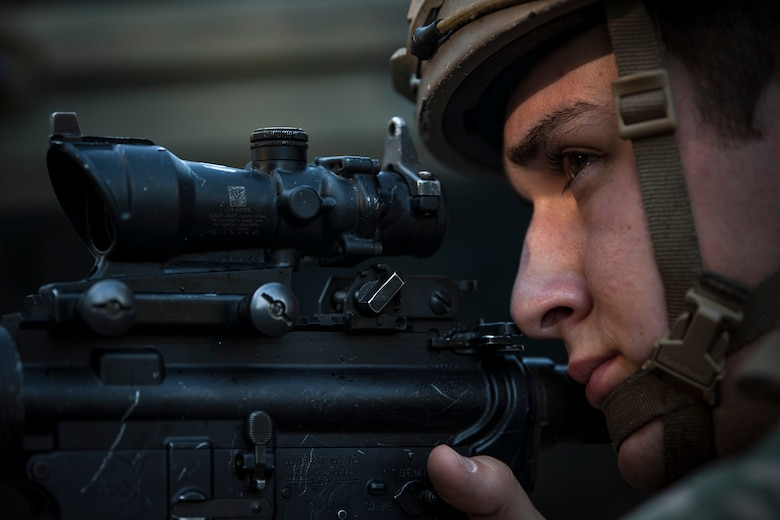 An Airman from the 822d Base Defense Squadron (BDS) aims down his sights during a full mission profile assessment, July 24, 2018, at Moody Air Force Base, Ga. The 'Safeside' defenders evaluated their base defense tactics and procedures while performing patrols, tactical combat casualty care and countering improvised explosive devices for a mission readiness exercise. After successfully completing these events, the defenders are eligible to earn their Global Response Force status, which certifies the unit to deploy worldwide. (U.S. Air Force photo by Airman Taryn Butler)