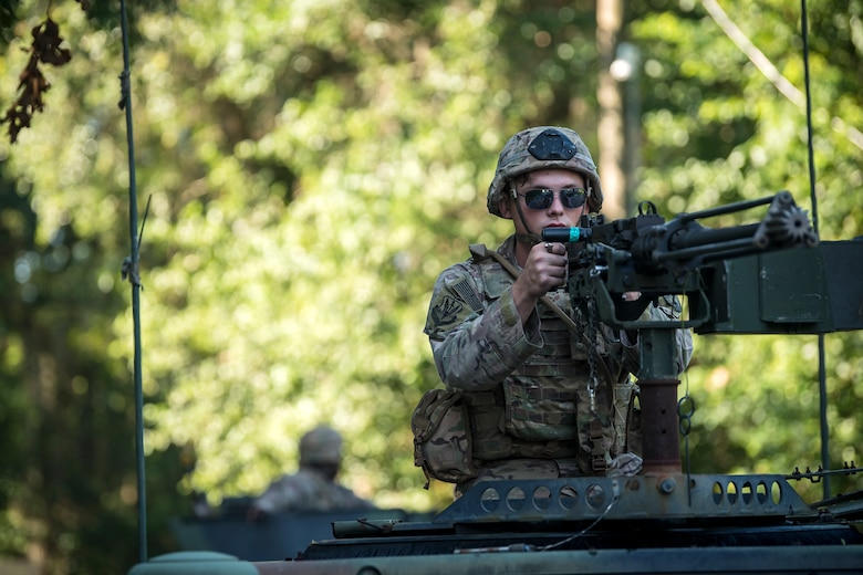 An Airman from the 822d Base Defense Squadron aims down the sights of an M2 machine gun, July 25, 2018, at Moody Air Force Base, Ga. The 'Safeside' defenders evaluated their base defense tactics and procedures while performing patrols, tactical combat casualty care and countering improvised explosive devices for a mission readiness exercise. After successfully completing these events, the defenders are eligible to earn their Global Response Force status, which certifies the unit to deploy worldwide. (U.S. Air Force photo by Airman 1st Class Eugene Oliver)