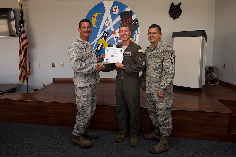 "First Lieutenant Clay Reierson, 86th Flying Training Squadron instructor pilot and flight scheduler, was chosen by wing leadership to be the ""XLer"" of the week, for the week of July, 23, 2018, at Laughlin Air Force Base, Texas. The ""XLer"" award, presented by Col. Charlie Velino, 47th Flying Training Wing commander, is given to those who consistently make outstanding contributions to their unit and the Laughlin mission. (U.S. Air Force photo by Airman 1st Class Anne McCready)"