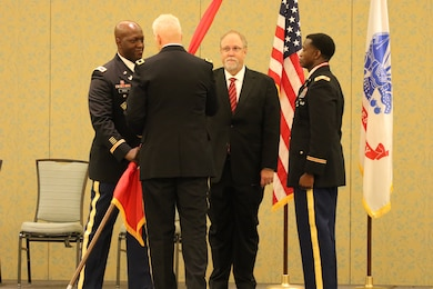 Col. Kenneth N. Reed assumed command from Col. Calvin C. Hudson II July 27 in a ceremony officiated by Brig. Gen. Paul E. Owen, U.S. Army Corps of Engineers Southwestern Division. The formal change of command ceremony took place at 2 p.m. at the Omni Hotel in Fort Worth, Texas.