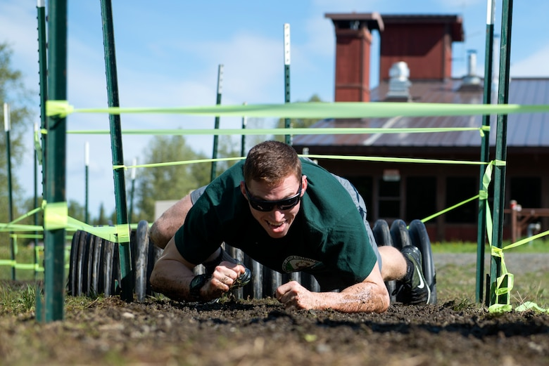 Airmen, Soldiers, and civilians participate in the Dirty Dozen challenge held during Resiliency Day at Joint Base Elmendorf-Richardson, Alaska, May 25, 2017. Dirty Dozen is a series of 12 challenges, each testing the team physically and intellectually.
