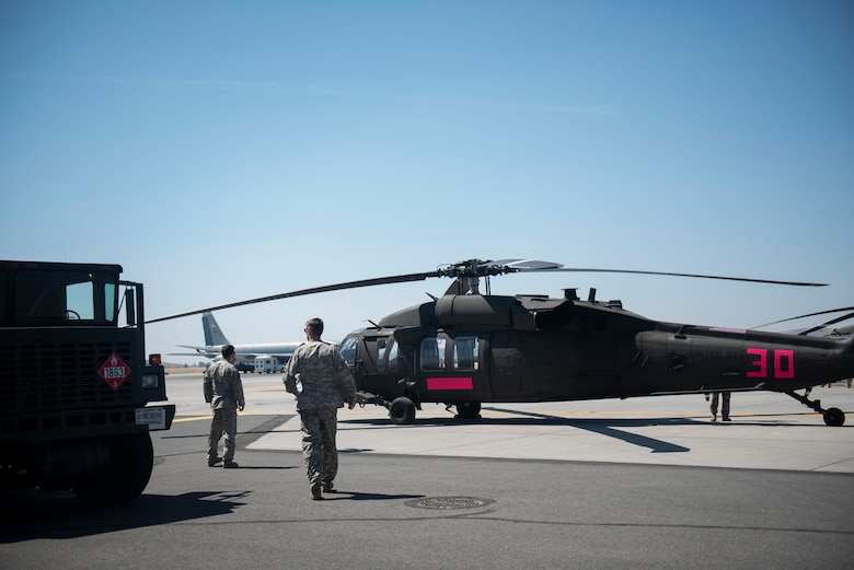 Washington National Guard petroleum, oil and lubricants Airmen from the 141st Air Refueling Wing fuel two WNG Sikorsky UH-60 Blackhawks at Fairchild Air Force Base, Washington, Aug. 1, 2018. Team Fairchild Airmen typically fuel KC-135 Stratotankers, but that skillset is flexible to allow them to fuel numerous mission partner airframes. (U.S. Air Force photo/Airman 1st Class Whitney Laine)