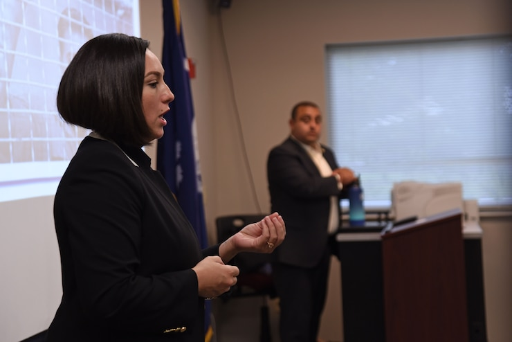 U.S. Air Force Special Agent Linzi Joseph, Headquarters Air Force Office of Special Investigations recruiting and applicant processing team member, speaks to Airmen during a recruiting team visit to the Spratt Education Center at Shaw Air Force Base, S.C., July 30, 2018.