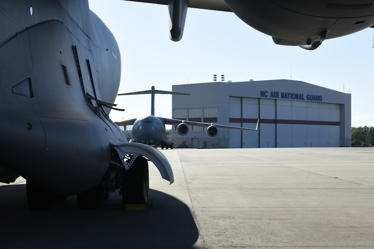 A North Carolina Air National Guard C-17 Globemaster III Aircraft sits on the flight line as it is prepped to transport Airmen and equipment from the 156th Aeromedical Evacuation Squadron from North Carolina Air National Guard Base, Charlotte Douglas International Airport, to Volk Field Air National Guard Base, Wisconsin, for a training exercise, July 9, 2018. (U.S. Air Force photo by Tech. Sgt. Nathan Clark)