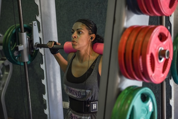 U.S. Air Force Master Sgt. Diana Valdez does part of her leg workout on the smith machine at Incirlik Air Base, Turkey, 2018