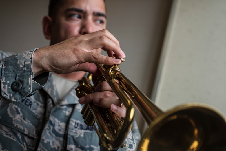 U.S. Air Force Capt. Charles Glover, the 35th Maintenance Squadron Operations officer, plays his trumpet in the Youth Center music room at Misawa Air Base, Japan, July 25, 2018. Glover is passionate about jazz music and plays in his spare time in order to relax. (U.S. Air Force photo by Airman 1st Class Collette Brooks)