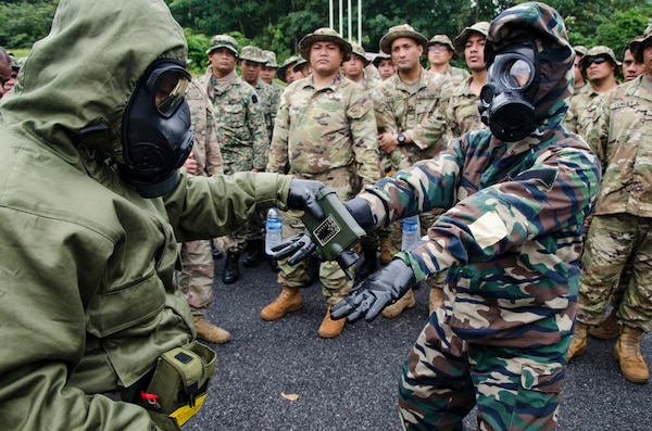 Soldiers with the 15th Royal Malay Regiment scan one another for contamination during Exercise Keris Strike, July 24, 2018, Camp Senawang, Malaysia. Malaysian and U.S. soldiers were working together to teach and train on basic decontamination procedures.