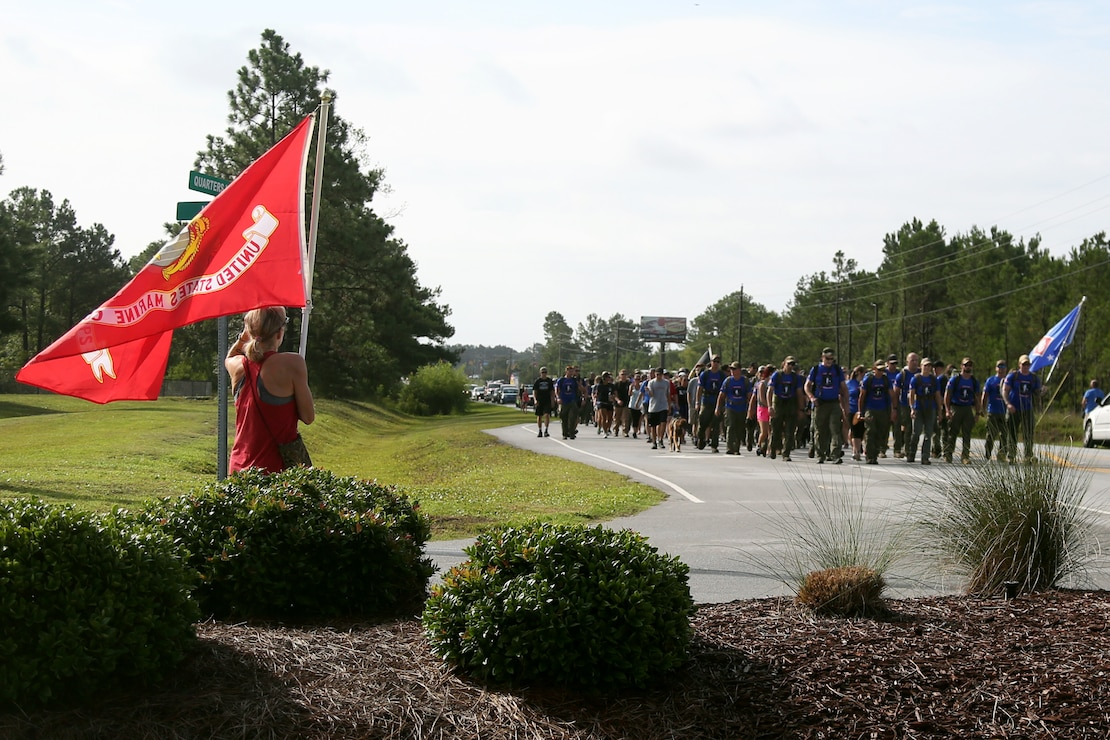 Marines, Sailors and local residents participate in the Marine Raider Memorial March in Sneads Ferry, N.C., July 27, 2018. The march spanned 900 miles from Mississippi to North Carolina, ending with a ceremony aboard Marine Corps Base Camp Lejeune. (U.S. Marine Corps photo by Sgt. Janessa K. Pon)