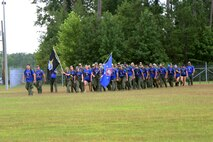 Marines, Sailors and Gold Star family members with the U.S. Marine Corps Forces, Special Operations Command arrive at the parade field aboard Marine Corps Base Camp Lejeune, N.C., during the Marine Raider Memorial March, July 27, 2018. A ceremony marked the completion of the 900-mile march beginning in Mississippi and ending in North Carolina over the course of 10 days in honor of fallen Raiders. (U.S. Marine Corps photo by Sgt. Janessa K. Pon)