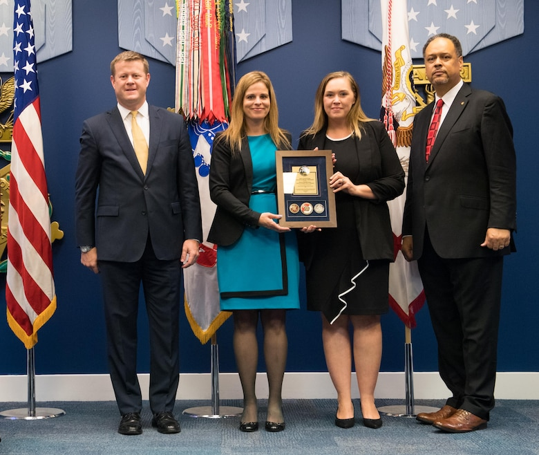 Undersecretary of the Army Ryan D. McCarthy (Left) presents the Army's Lean Six Sigma Process Improvement Program Team Excellence Award in the Non-Enterprise, Non-Gated Level July 25, 2018 to Ashley Klimaszewski, supervisory real estate specialist with the Louisville District (formerly with the Nashville District – Second from Left), and Kathryn Wall, Nashville District Real Estate Division realty specialist, during the 2017 Lean Six Sigma Excellence Awards Program Ceremony in the Hall of Heroes at the Pentagon in Arlington Va.  Dr. Charles Brandon, director of the Office of Business Transformation, joined McCarthy for the presentation. (U.S. Army photo by Staff Sgt. Brandy N. Mejia)