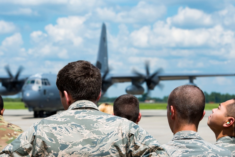 Air Force Reserve Officer Training Corps cadets watch an HC-130J Combat King II taxi on the flightline during Operation Air Force 2018, July 26, 2018, at Moody Air Force Base, Ga. From June 2-Aug. 1, three groups of cadets from across the nation participated in the annual program which gave them an opportunity to see the operational Air Force's mission and lifestyle before choosing a career as an officer. (U.S. Air Force photo by Airman 1st Class Erick Requadt)