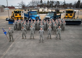 Members of the 133rd Civil Engineer Squadron pose for a group photo in St. Paul, Minn., Mar. 18, 2017.