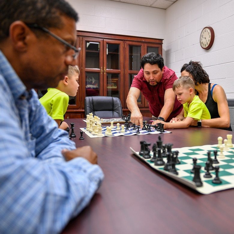 Marc Garcia provides instruction to players during a chess club meeting at Hill Air Force Base, Utah, July 26, 2018. Hosted by the Gerrity Memorial Library, the club weclomes players of all ages and skill levels. (U.S. Air Force photo by R. Nial Bradshaw)