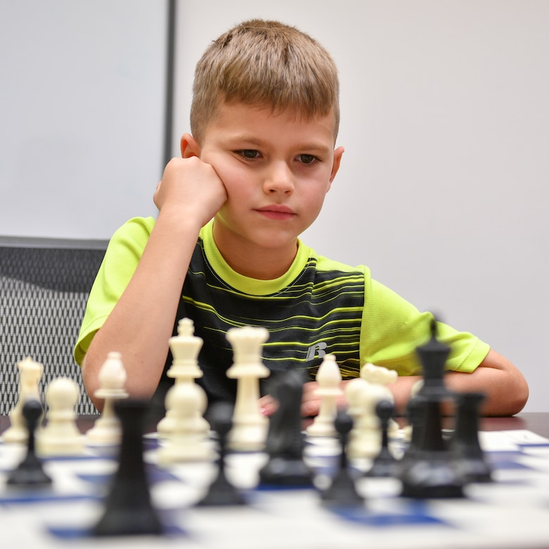 Roman Widmer considers his next move during a chess club meeting at Hill Air Force Base, Utah, July 26, 2018. The club is hosted by the Gerrity Memorial Library every other Thursday and is open to anyone with base access. (U.S. Air Force photo by R. Nial Bradshaw)