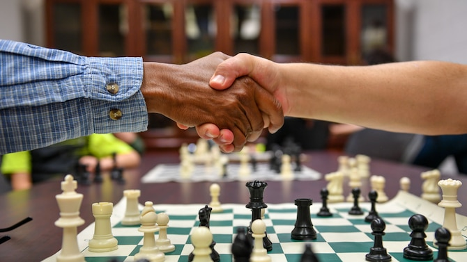 Players shake hands after a match during a chess club meeting at Hill Air Force Base, Utah, July 26, 2018. The club meets every other Thursday and is open to anyone with base access. (U.S. Air Force photo R. Nial Bradshaw)