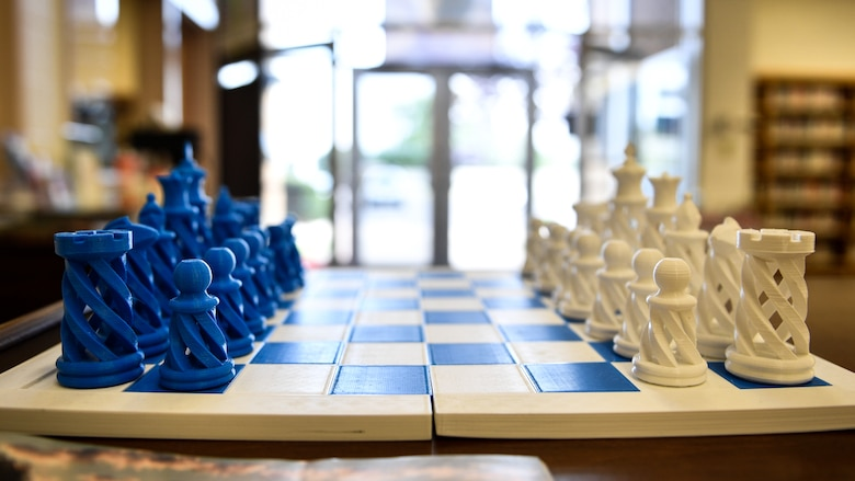 A chess set printed by the Gerrity Memorial Library's 3-D printer sits on a table at Hill Air Force Base, Utah, July 26, 2018. Visitors can bring in 3-D printer programs and have their projects printed by library staff. (U.S. Air Force photo by R. Nial Bradshaw)