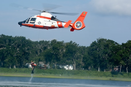 An MH-65 Dolphin helicopter assigned to Coast Guard Air Station Savannah deploys a rescue swimmer to rescue a simulated downed pilot during a Search and Rescue (SAR) exercise July 27. The training was the first SAR exercise to involve F-35B Lightning II pilots.
