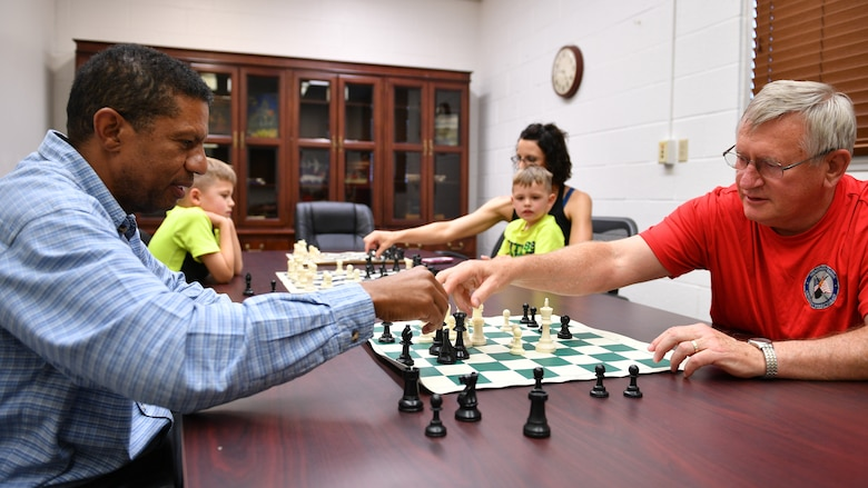 Roy Cole, left, and Neal Booher play a match during a 75th Support Squadron Chess Club meeting at Hill Air Force Base, Utah, July 26, 2018. The club is open to players of all ages and skill levels. (U.S. Air Force photo by R. Nial Bradshaw)