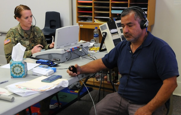 Maj. Sheri Loveland, an Army Reserve audiologist assigned to 7451st Medical Backfill Battalion, based out of Joint Base Lewis-McChord, Washington, tests a patient's hearing during his audio screening at Escontrias Early Childhood Center in Socorro, Texas. Loveland is one of approximately 50 U.S. Army Reserve and U.S. Army Soldiers who are working in partnership with the Texas A&M Colonias program to provide medical care to El Paso County's underserved colonias population. Services provided by military personnel are done through the Department of Defense's Innovative Readiness Training, a civil-military program that builds mutually beneficial partnerships between U.S. communities and the DOD. The missions selected meet training & readiness requirements for Army Reserve service members while integrating them as a joint and whole-of-society team to serve our American citizens.