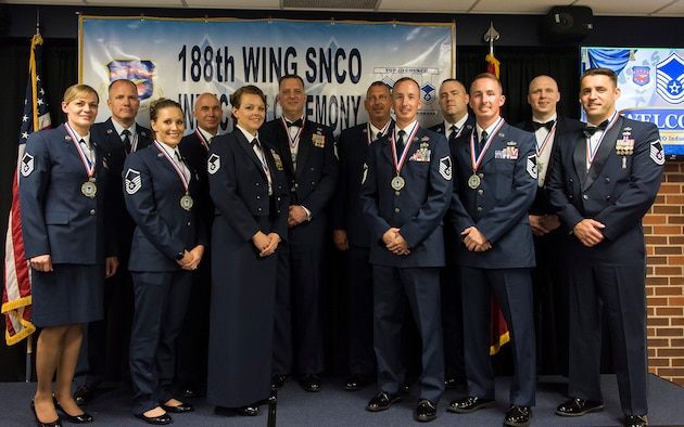 New senior non-commissioned officers with the 188th Wing, Arkansas Air National Guard, pose for a photo during the wing's inaugural Senior Non-commissioned Officer Induction Ceremony, held at Ebbing Air National Guard Base, Ark., June 2, 2018. The wing celebrated the accomplishments of its newest senior NCOs during the evening's event. (U.S. Air National Guard photo by Tech. Sgt. John E. Hillier)