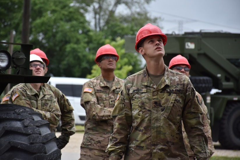 U.S. Army Reserve Soldiers from the 317th Engineer Company, out of Homewood, Ill., act as safety officers during the assembly of a 4,000 square foot Quonset hut at Joliet Training Area, in Elwood, Ill., July 20.