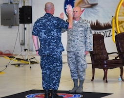 U.S. Navy Cmdr. Matthew Scott administers the oath of office to Chief Master Sgt. Matthew Coltrin during the first enlisted frocking ceremony in Air Education and Training Command on Aug. 1, 2018 at Eglin AFB, Fla. A frocking ceremony allows a military member to pin on new rank prior to their promotion date. (U.S. Air Force photo by 1st Lt. Savannah Stephens)