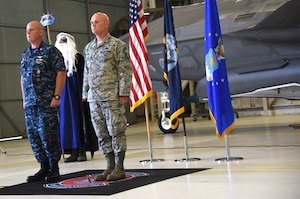U.S. Navy Cmdr. Matthew Scott and Chief Master Sgt.(select) Matthew Coltrin stand at attention while the promotion orders are read during the first enlisted frocking ceremony in Air Education and Training Command on Aug. 1, 2018 at Eglin AFB, Fla. A frocking ceremony allows a military member to pin on new rank prior to their promotion date. (U.S. Air Force photo by 1st Lt. Savannah Stephens)