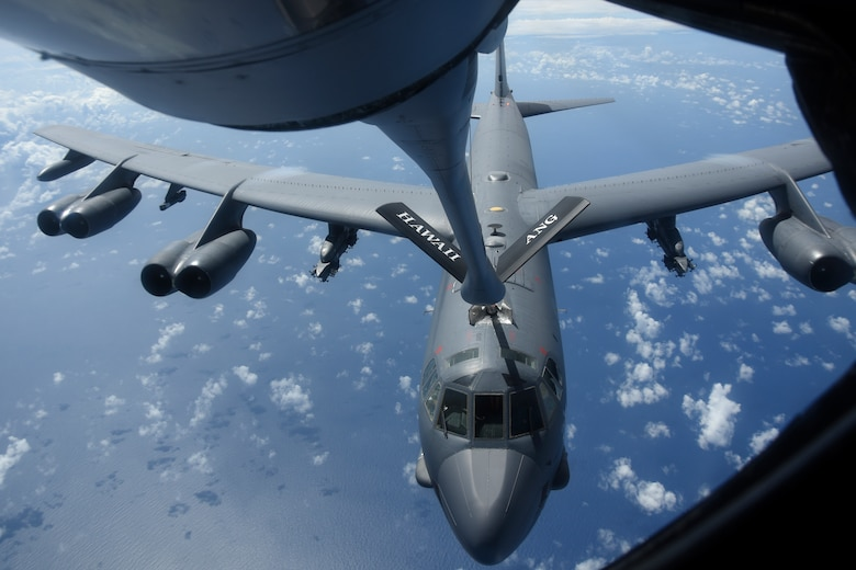 A U.S. Air Force B-52H Stratofortress bomber gets refueled over the Pacific Ocean during a routine training mission Aug. 2, 2018. This mission was flown in support of U.S. Indo-Pacific Command's Continuous Bomber Presence operations, which are a key component to improving combined and joint service interoperability. (U.S. Air Force photo by Airman 1st Class Gerald R. Willis)