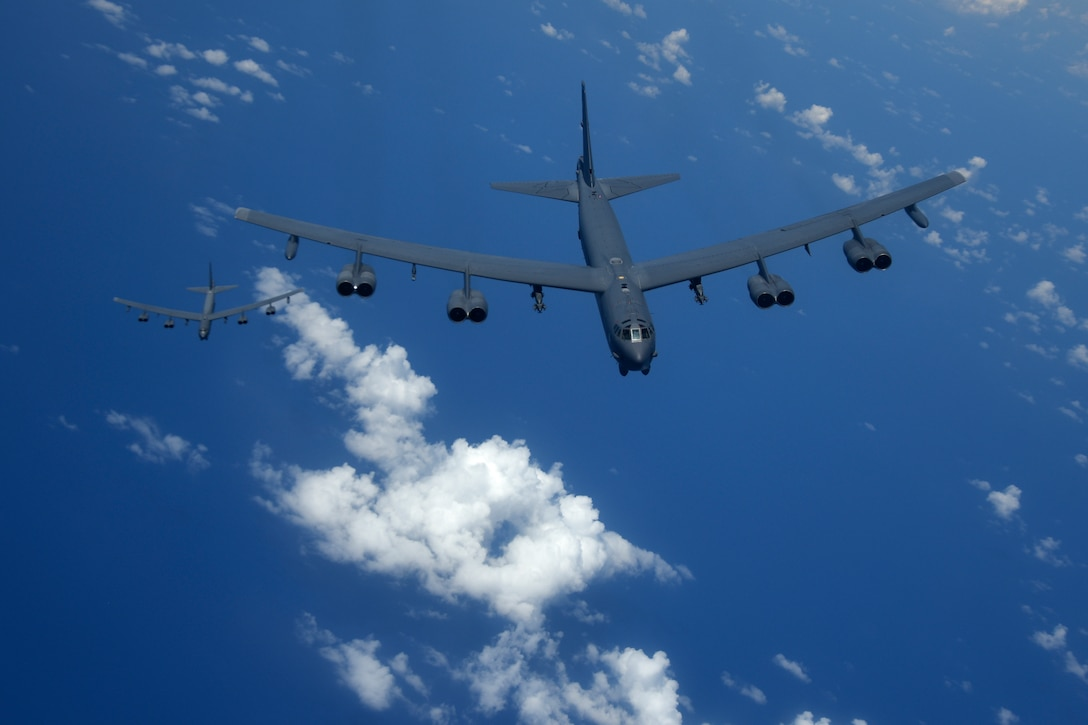 Two U.S. Air Force B-52H Stratofortress bombers fly over the Pacific Ocean during a routine training mission Aug. 2, 2018. This mission was flown in support of U.S. Indo-Pacific Command's Continuous Bomber Presence operations, which are a key component to improving combined and joint service interoperability. (U.S. Air Force photo by Airman 1st Class Gerald R. Willis)