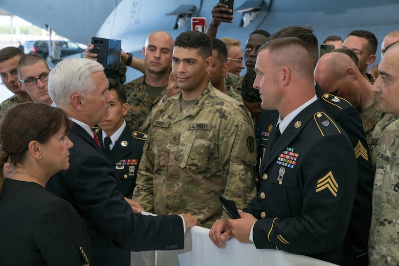 Vice President Michael R. Pence speaks with troops during a troop engagement on Joint Base Pearl Harbor on August 1, 2018. Pence gave remarks at the honorable carry ceremony held at JBPH-H, honoring the memory of those lost during the Korean War and welcoming home the remains of the fallen. Following the ceremony, he met with approximately 100 local service members and their families from all military branches. Pence mingled amongst the troops shaking hands, taking photos and thanking them for their service. (U.S. Air Force photo by Staff Sgt. Daniel Robles)