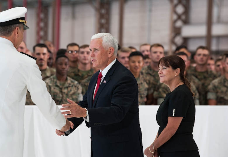 Vice President Michael R. Pence shakes hands with Adm. Philip S. Davidson, U.S. Indo-Pacific Command commander (USINDOPACOM) during a troop engagement on Joint Base Pearl Harbor-Hickam, August 1, 2018. Pence gave remarks at the honorable carry ceremony held at JPBH-H, honoring the memory of those lost during the Korean War and welcoming home the remains of the fallen. Following the ceremony, he met with approximately 100 local service members and their families from all military branches. Pence mingled amongst the troops shaking hands, taking photos and thanking them for their service. (U.S. Air Force photo by Hailey Haux)