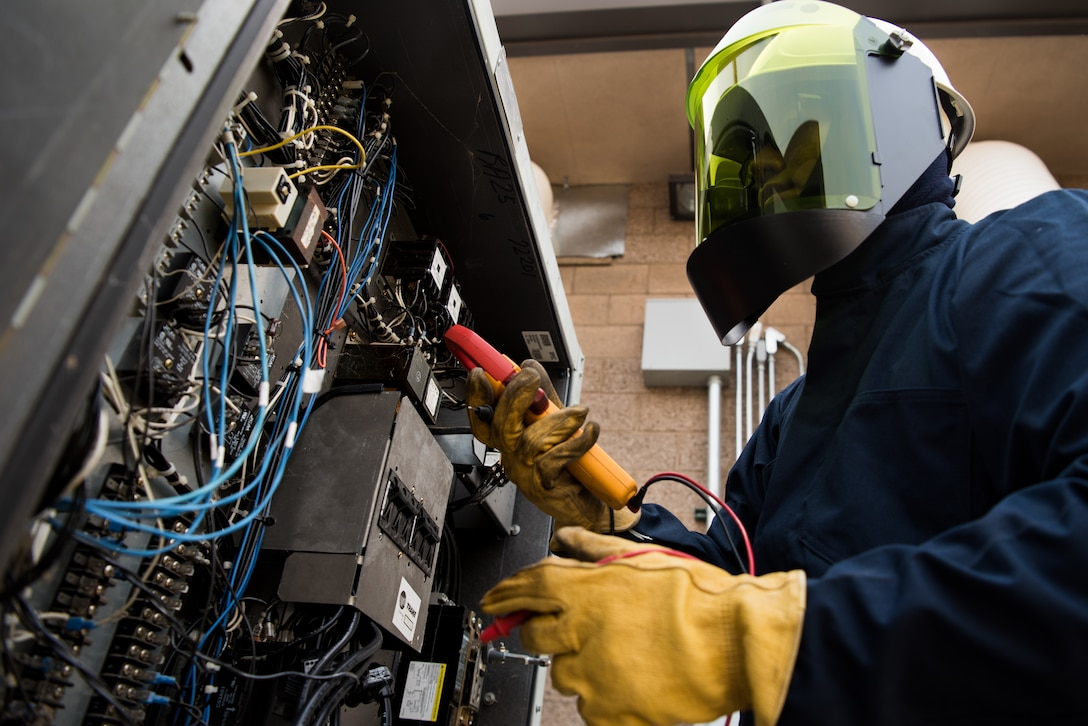 Airman 1st Class Charles Song, 9th Civil Engineer Squadron heating, ventilation and air conditioning technician, inspects electrical connections to determine the cause of systems malfunction at Beale Air Force Base, California, Aug. 2, 2018. HVAC Airmen are required to wear personal protective equipment when working on systems that have hazards such as refrigeration high pressure and units with up to 480 voltages. (U.S. photo by Senior Airman Justin Parsons)