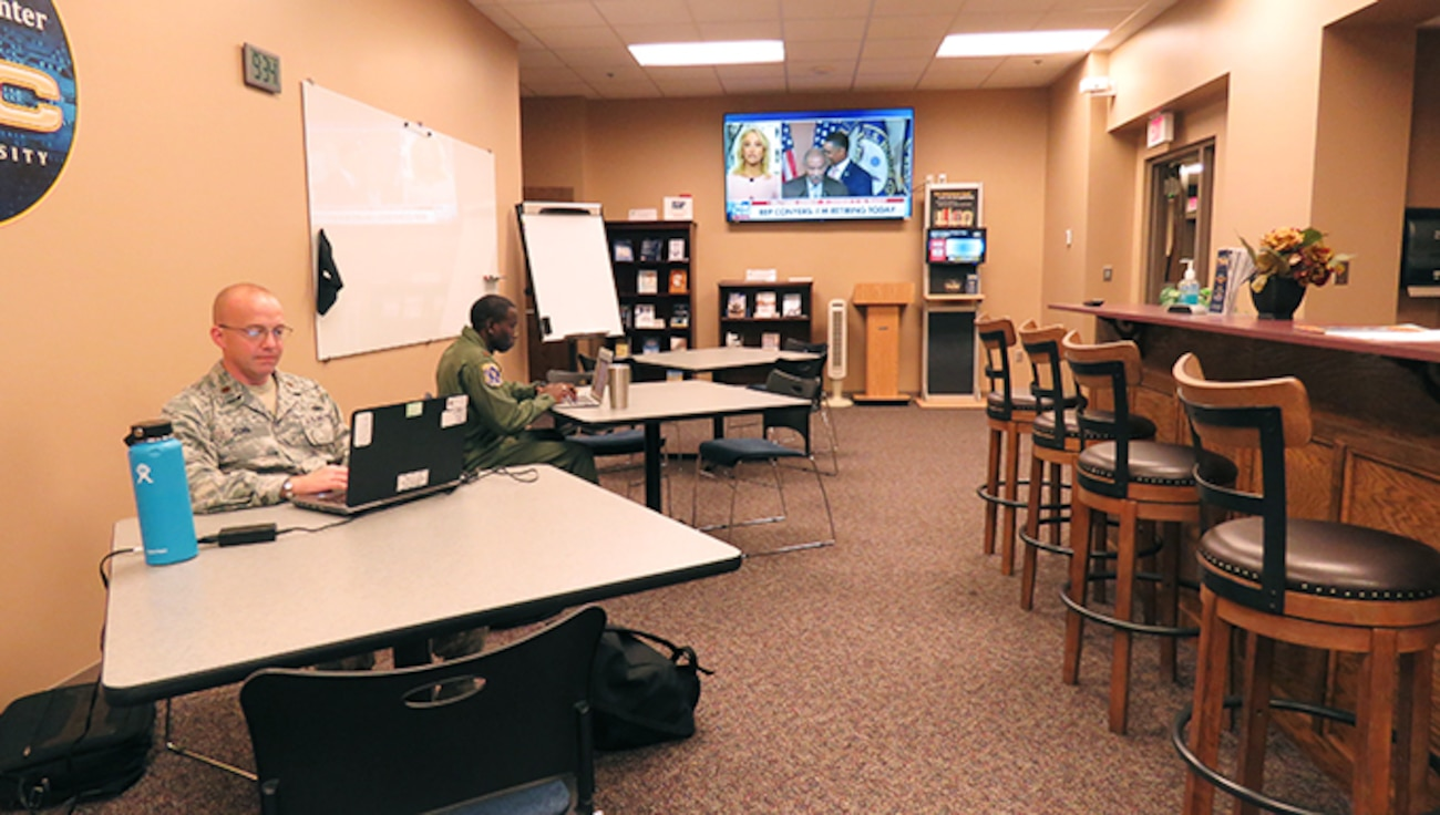 Professional study space with coffee bar and tables