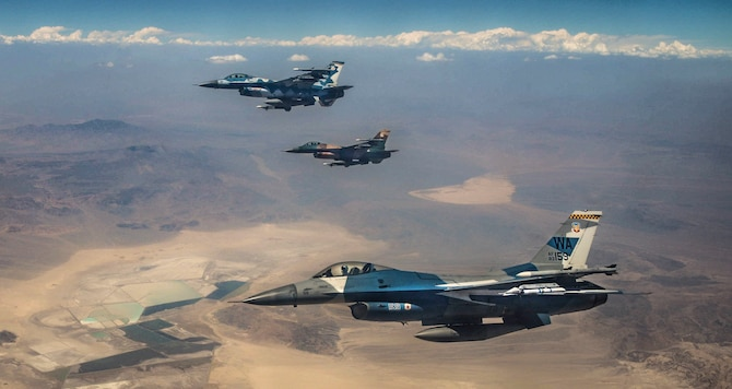 Three F-16 Fighting Falcon fighter jets assigned to the 64th Aggressors Squadron (AGRS) fly over the Nevada Test and Training Range during Red Flag 18-3. The 64th AGRS served as part of the red forces during Red Flag 18-3 to prepare combat air forces, joint and allied aircrews for tomorrow's victories with challenging and realistic scenarios. (U.S. Air Force photo by Airman Bailee A. Darbasie)