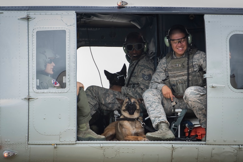 Staff Sgt. Michael Dacoron, 374th Security Forces Squadron military working dog handler, and Diesel, 374 SFS MWD, wait for takeoff in a UH-1N helicopter during a 459th Airlift Squadron MWD familiarization flight July 26, 2018, at Yokota Air Base, Japan.