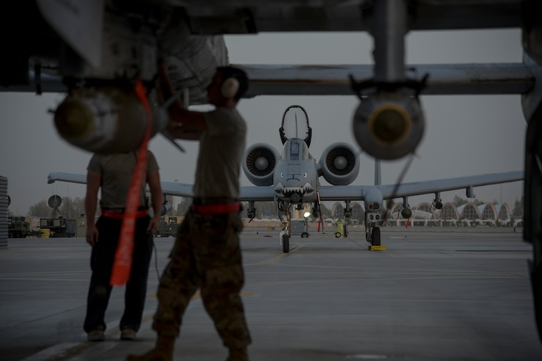 Crew chiefs from the 75th Expeditionary Fighter Squadron conduct pre-flight checks on an A-10C Thunderbolt II before take-off from Kandahar Airfield, Afghanistan, Aug. 2, 2018. The Airmen, from Moody Air Force Base, Georgia, are deployed in support of Operation Freedom's Sentinel by providing close-air support to Afghan forces and other coalition partners. The Thunderbolt II can employ a wide variety of conventional munitions, including general purpose bombs, cluster bomb units, laser guided bombs, joint direct attack munitions or JDAM, wind corrected munitions dispenser or WCMD, AGM-65 Maverick and AIM-9 Sidewinder missiles, rockets, illumination flares and the GAU-8/A 30mm cannon, capable of firing 3,900 rounds per minute. (U.S. Air Force photo by Staff Sgt. Kristin High)