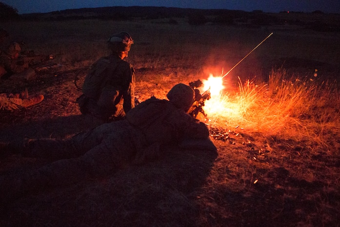 U.S. Marines with Special Purpose Marine Air-Ground Task Force-Crisis Response-Africa fire an M-240B medium machine gun during a night unknown-distance range in Baumholder, Germany, July 25, 2018. SPMAGTF-CR-AF deployed to conduct crisis-response and theater-security operations in Europe and Africa.