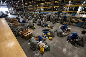 Airmen from the 141st Air Refueling Wing prepare their emergency response and fire equipment bags during a statewide activation of Air and Army National Guard personnel in support of firefighting efforts in eastern Washington August 1, 2018. Gov. Jay Inslee activated National Guard personnel to assist in firefighting efforts throughout the region.  (U.S. Air National Guard photo by Staff Sgt. Rose M. Lust)