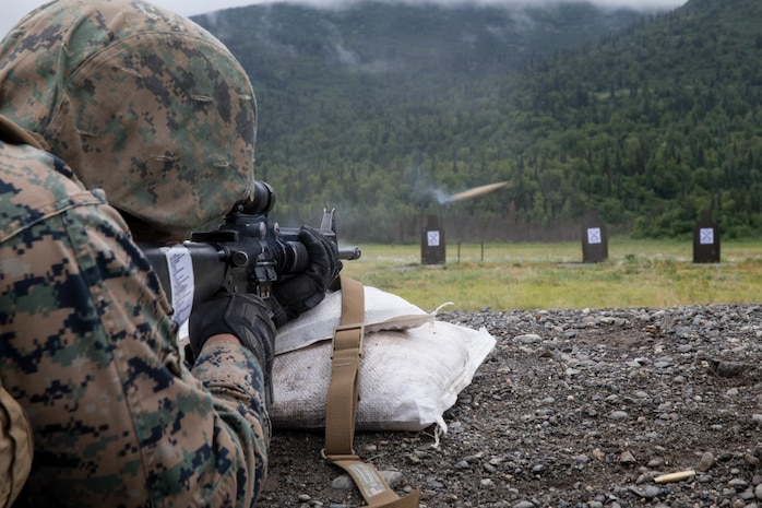 Lance Cpl. Joel Carrizales, with Charlie Company, 1st Battalion, 25th Marine Regiment, zeroes in his rifle at the 25-yard-line, Joint Base Elmendorf-Richardson, Anchorage, Alaska, August 1, 2018. Super Squad Competitions were designed to evaluate a 14-man infantry squad throughout an extensive field and live-fire evolution. (U.S. Marine Corps photo by Lance Cpl. Samantha Schwoch/released)