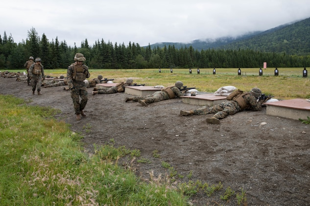 Marines competing in the 4th Marine Division Annual Rifle Squad Competition, zero in their rifles at the 25-yard-line, Joint Base Elmendorf-Richardson, Anchorage, Alaska, August 1, 2018. Super Squad Competitions were designed to evaluate a 14-man infantry squad throughout an extensive field and live-fire evolution. (U.S. Marine Corps photo by Lance Cpl. Samantha Schwoch/released)