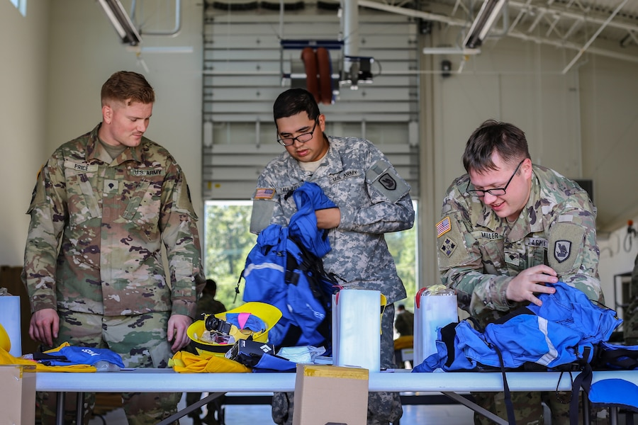 National Guardsmen train to set up emergency fire shelters.