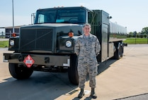 Tech. Sgt. Brandon Wright, 375th Logistics Readiness Squadron stands near a fuel truck.