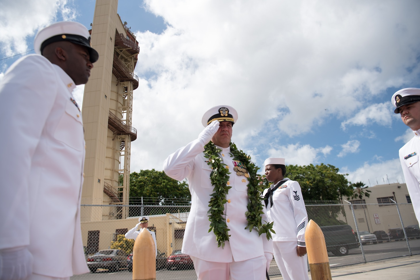Cmdr. John C. Roussakies, commanding officer of the Virginia-class fast-attack submarine USS Hawaii (SSN 776), walks through the side boys during a change of command ceremony on the submarine piers in Joint Base Pearl Harbor-Hickam, August 2. Cmdr. Sterling S. Jordan relieved Roussakies as Hawaii's commanding officer.