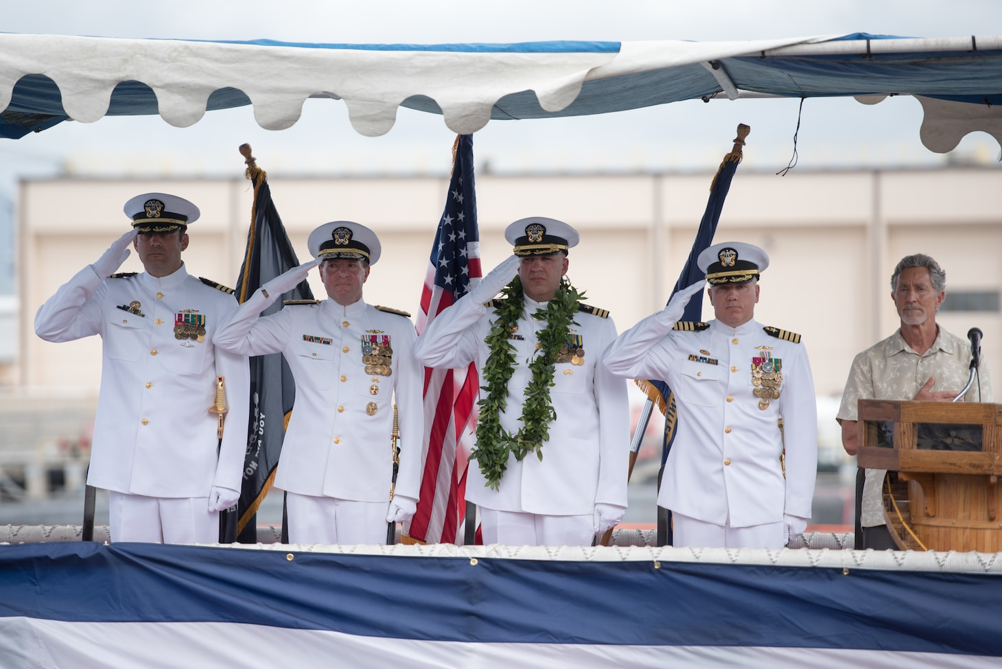 PEARL HARBOR (August 2, 2018) - The official party salutes during a change of command ceremony of the Virginia-class fast-attack submarine USS Hawaii (SSN 776) on the submarine piers in Joint Base Pearl Harbor-Hickam, August 2. Cmdr. Sterling S. Jordan relieved Cmdr. John C. Roussakies as Hawaii's commanding officer.