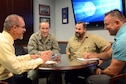 From left, Joe Stupic, KC-10 system program manager; Maj. Ron Synakowski, KC-10 branch chief; Scott Staats, KC-10 depot program manager; and Duane Tubbs, KC-10 large component manager meet for a briefing on flight manuals.