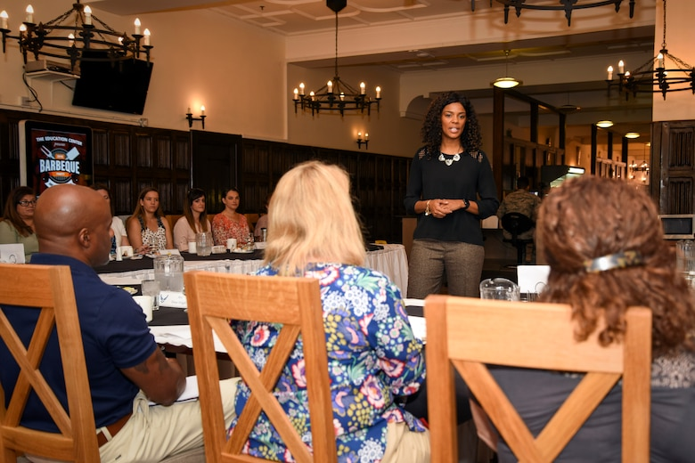 Tonya Wright, spouse of Chief Master Sgt. of the Air Force Kaleth O. Wright, speaks with Team Mildenhall spouses during a breakfast at the Gateway Dining Facility at RAF Mildenhall, England, Aug. 2, 2018. Mrs. Wright met with Team Mildenhall spouses, where she answered questions and listened to their perspectives as military spouses. (U.S. Air Force photo by Senior Airman Christine Groening)