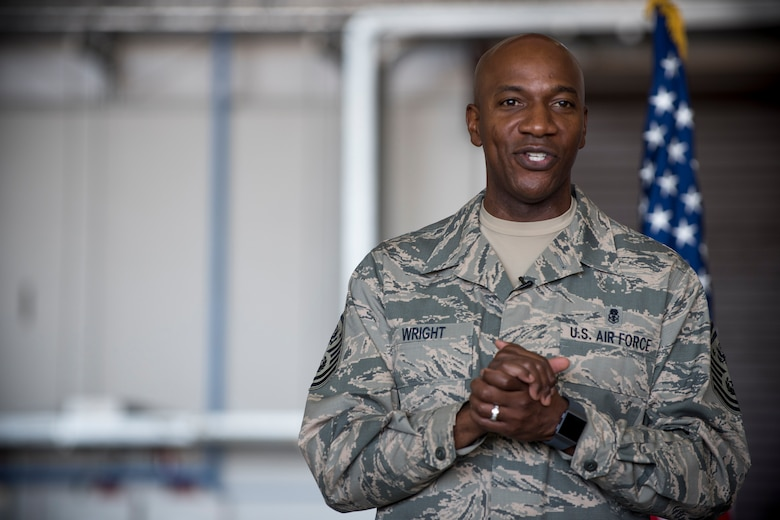 Chief Master Sgt. of the Air Force Kaleth O. Wright speaks to Team Mildenhall Airmen during an all call, at RAF Mildenhall, England, Aug. 2, 2018. Wright also visited multiple units on base to engage U.S. Air Force Airmen about resiliency, leadership and readiness.  (U.S. Air Force photo by Senior Airman Christine Groening)