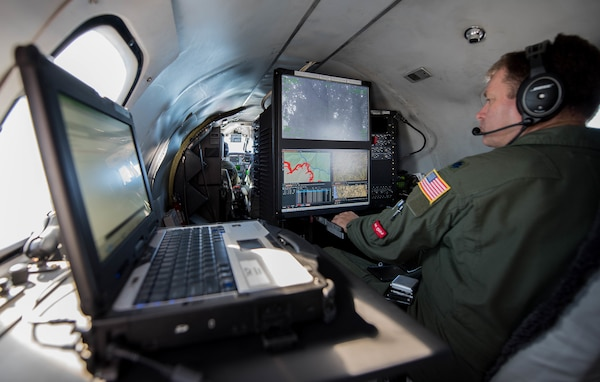 U.S. Air Force Lt. Col. Andy Rathbum, an RC-26 mission system operator assigned to the141st Operations Group, Washington Air National Guard, maps the Chetco Bar fire in southern Oregon using the RC-26's camera Sept. 2, 2017, Brookings, Oregon. Before the RC-26 were used to map fires, firefighters would drive out along the fire line to map out its location, taking hours to complete, putting the firefighters in danger and causing information to be 25-36 hours out of date.